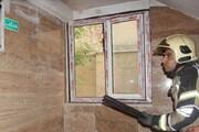 نجات ۲۷ نفر از آتشسوزی یک منزل مسکونی