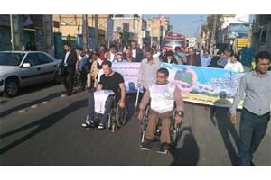 مسئولان  در کنار معلولان خیابان های شهرستان   ملارد را  نظافت و پاکسازی  کردند