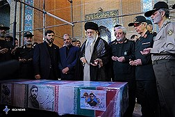 Ayatollah Khamenei Stands Beside Holy Body of Martyr Hojaji/ In Photos