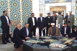 ادای احترام دکتر طهرانچی به شهدای گمنام دانشگاه آزاد اسلامی مشهد