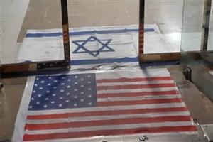 معاون فرهنگی دانشگاه شبانه پرچم آمریکا را پاک کرد