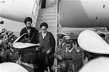 This file photo, taken on February 1, 1979 at the Tehran airport, shows Ayatollah Rouhollah Khomeini (C), the founder of the Islamic Republic, leaving the Air France Boeing 747 jumbo that flew him back from exile in France to Tehran. (By AFP)